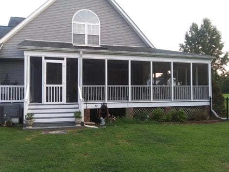 Wrap Around Screen Porch with Five Bar Vinyl Door